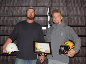 Congrats to Koen Gronbach from Berne Union High School, who was named South Central Power Lineman of the Week last Friday! He's presented his award by James Cox, a South Central Power lineman in Lancaster.
